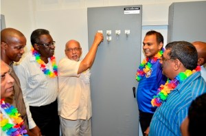 (From left to right)Former West Indian Cricket Captain Clive Lloyd, President Donald Ramotar and Minister of Youth, Sport and Culture Dr. Frank Anthony flicking  the switch at the commissioning of the $91M lighting system, at the Albion Sports Ground