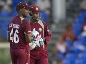 Denesh Ramdin and Darren Bravo share a light moment during their record breaking third wicket stand of 258 runs.