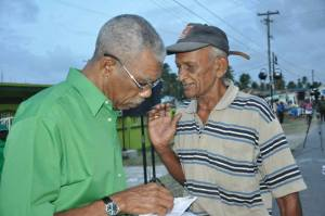 Leader of the APNU, David Granger interacts with a resident during one of the Party's outreaches.