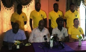 Odinga Lumumba (second from left) in the presence of some Alpha United members during the press conference.