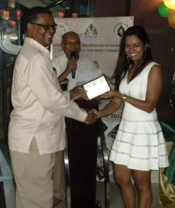 Mrs Kamini Persaud presents an award to President of the Guyana, Gold & Diamond Miners Association, Patrick Harding.
