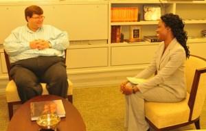 Chargé d'Affaires Bryan  Hunt and IVLP Participant Dr. Nedd - Jerrick