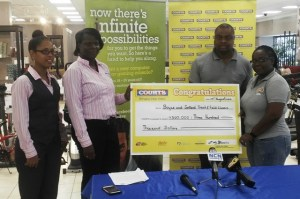 Shanomae Blackmore, Secretary of the Boyce/Jefford Classic receives a cheque for $300,000 in the presence of Edison Jefford (second from right)