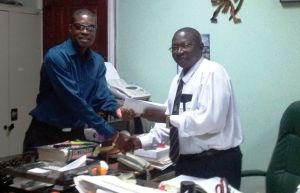 – General Secretary of the Alliance for Change (AFC), David Patterson submits the motion to Clerk of the National Assembly, Sherlock Isaacs