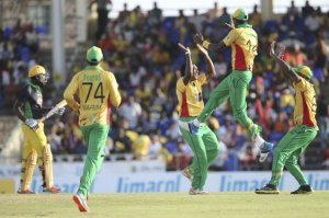 Amazon Warriors celebrate the wicket of Andre Russel.