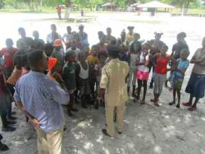 Commander Hicken speaking to some of the children. [iNews' Photo]
