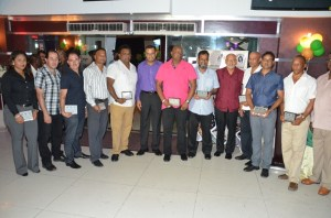 Mining sector awardees with President Donald Ramotar and Minister of Natural Resources and the Environment, Robert Persaud. [GINA Photo]