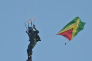 A GDF paratrooper coming down on the grounds of the Guyana National Stadium