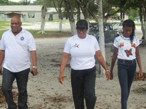 Assistant Commissioner of Police Balram Persaud is escorted into the camp chapel by camp mother Denise Fowler and one of the campers. [iNews' Photo]