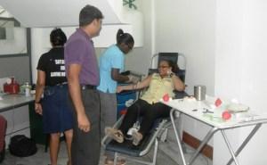 A Demerara Bank customer donates blood. [iNews' Photo]