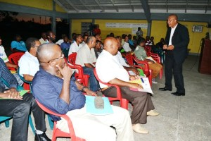 Clinical psychologist and pro-guidance counsellor Dr. Mark Constantine interacts with men at the Domestic violence session at the West Demerara Secondary School. [GINA Photo]