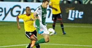 Jack Jewsbury controls a ball versus Alpha United
