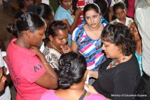Education Minister, Priya Manickchand interacts with parents.