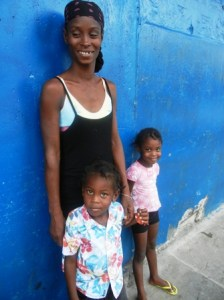 Omela Charles and two of her children. [iNews' Photo]