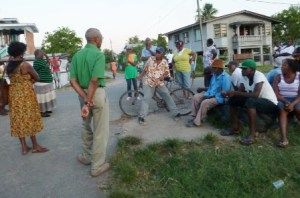 Granger interacts with villagers at the roadside in Perth, Mahaicony.
