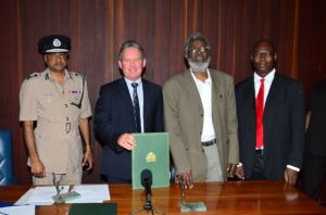 Police Commissioner (ag)  Seelall Persaud, British High Commissioner Andrew Ayre, Head of the Presidential Secretariat Dr. Roger Luncheon and Head of SOCU, Lt. Col Sydney James after the signing of the MOU for the training and mentoring of staff attached to the Special Organised Crime Unit