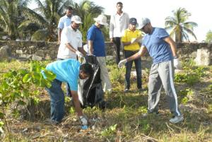 Prime Minister Samuel Hinds and Minister of Natural Resources and the Environment Robert Persaud participate in the coastal clean-up at the Georgetown seawall