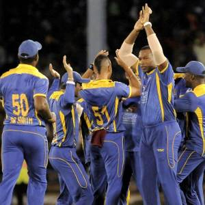 Barbados Tridents celebrate the fall of a wicket.
