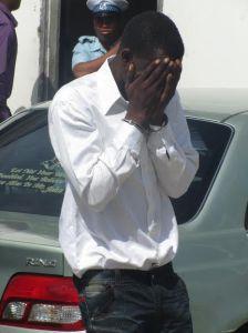 Melroy Davis hides his face