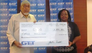 Marketing Manager of GT&T Fay Wharton receives the cheque from CIOG President Fazeel Ferouz. [iNews' Photo]