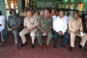 From left, Director of Prison, Welton Trotz, Commissioner of Police (Ag.) Seelall Persaud, Chief of Staff of the Guyana Defence Force, Mark Phillips, Home Affairs Minister Clement Rohee and Fire Chief Marlon Gentle during the church service which was held to usher in Fire Prevention Week, 2014. [GINA Photo]