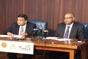 Executive Director of IAST, Dr Suresh Narine [right] and Executive Director of Pinnacle Green Resources, Manu Basal.