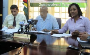 L -R: Permanent Secretary within the Ministry of Local Government, Colin Croal; Minister Norman Whittaker and Public Relations Officer of the initiative, Olive Gopaul. [iNews Photo]