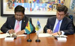 Minister of Finance, Dr Ashni Singh and President of the IDB, Alberto Luis Alberto Moreno signing the agreements.