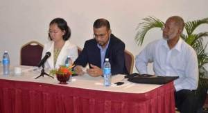 Minister of Natural Resources and Environment, Robert Persaud flanked by UNDP Deputy Resident Representative, Chisa Mikami and representative from the Guyana Gold and Diamond Miners Association, William Woolford