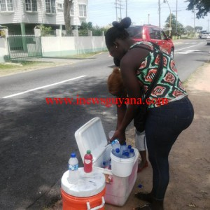 Some of the water vendors at the junction of Vlissengen/Irving-Lahama