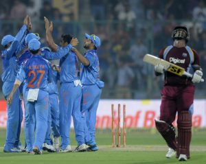 India celebrates the wicket of Dwayne Smith