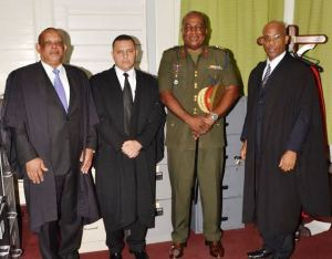 Guyana Defence Force Major, Michael Shahoud [second from left] followed by Brigadier Mark Phillips and others.