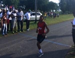 Daniel Gaskin eases across the finish line. [iNews' Photo]