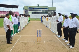 Players observe at minute of silence at the Guyana National Stadium.