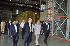 President Donald Ramotar being given a tour of the Courts Distribution Centre. [GINA Photo]