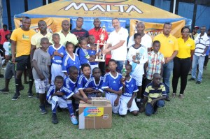 The winning Stella Maris team poses with their trophy and prizes.