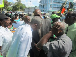 Opposition Leader, David Granger joins protesters outside of Parliament. [iNews' Photo]