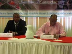 , Training and Security Supervisor at Caribbean Airlines, Willard McIntyre and Home Affairs Minister, Clement Rohee. [iNews' Photo]