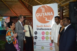 Prime Minister Samuel Hinds and Minister of Tourism, Irfaan Ali at the unveiling of  Destination Guyana's new logo. [GINA Photo]