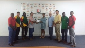 Anjali Beharry-Strand hands over the sponsorship cheque to Peter Green.
