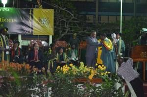 Prime Minister Samuel Hinds conferring the President's medal on Valedictorian, Joel Joseph