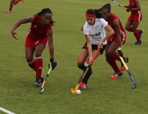 Guyanese Samantha Fernandes (white) surrounded by Trinidadian defenders