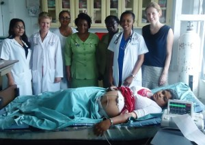 Staff of Georgetown Public Hospital Maternity Ward with Vice President of GHTK, Dr. Andrea Hunter first right and a patient attached to the fetal monitor