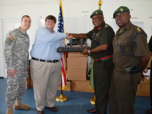 Charge Hunt presents equipment to Brigadier Phillips