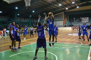 Christopher Barnwell rises for the floater. [iNews' Photo]