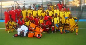 Members of the two teams pose for a photo before the game on Monday night.