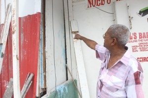 Businessman, Looknarine Basdeo points out where the bandits gained entry. [iNews' Photo]