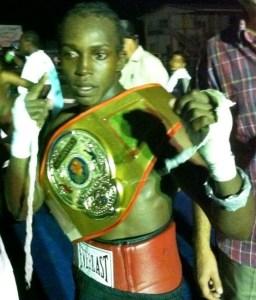 Richard Williamson poses as the New Super Bantamweight champion.