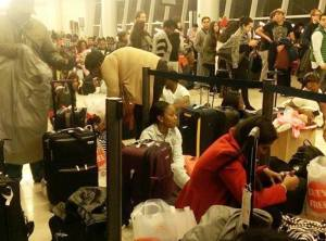 Stranded Dynamic Airways passengers at JFK Airport