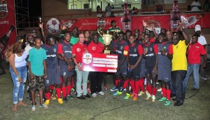 Alpha United poses with officials from the GFA and Banks DIH after receiving their trophy and cheque.